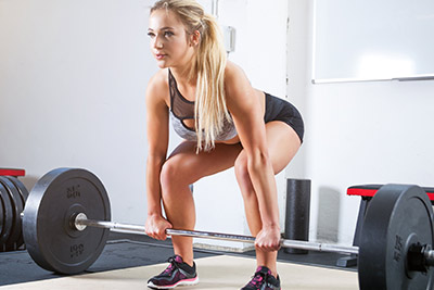 Woman lifting weights as a deadlift
