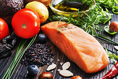Display of Salmon, Olive Oil, and healthy food ingredients