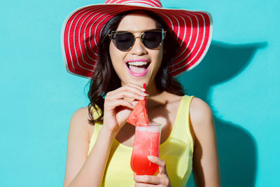 woman drinking watermelon drink