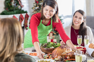 woman serves holiday meal