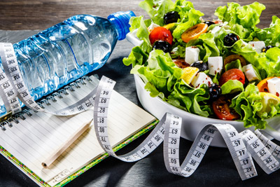 salad, water bottle, food journal