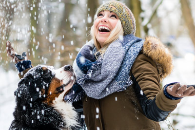 woman with a dog in the snow